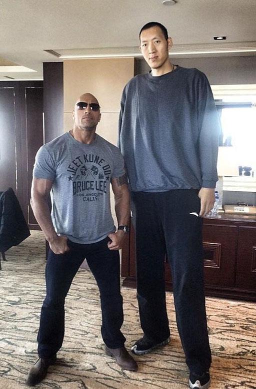 Dwayne The Rock Johnson Standing Next to Sun Ming Ming
