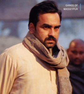 Pankaj Tripathi standing and giving angry look gangs of Wasseypur meme template