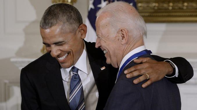 Obama laughing with Joe Biden meme template