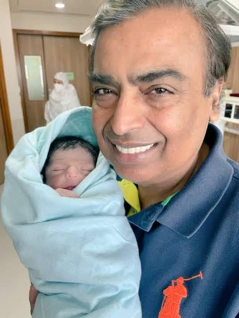 mukesh Ambani with his grandson meme template