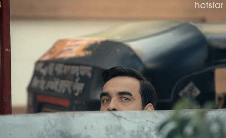 pankaj Tripathi peeking from wall criminal justice meme template