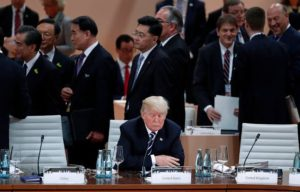 Trump sitting alone on a chair