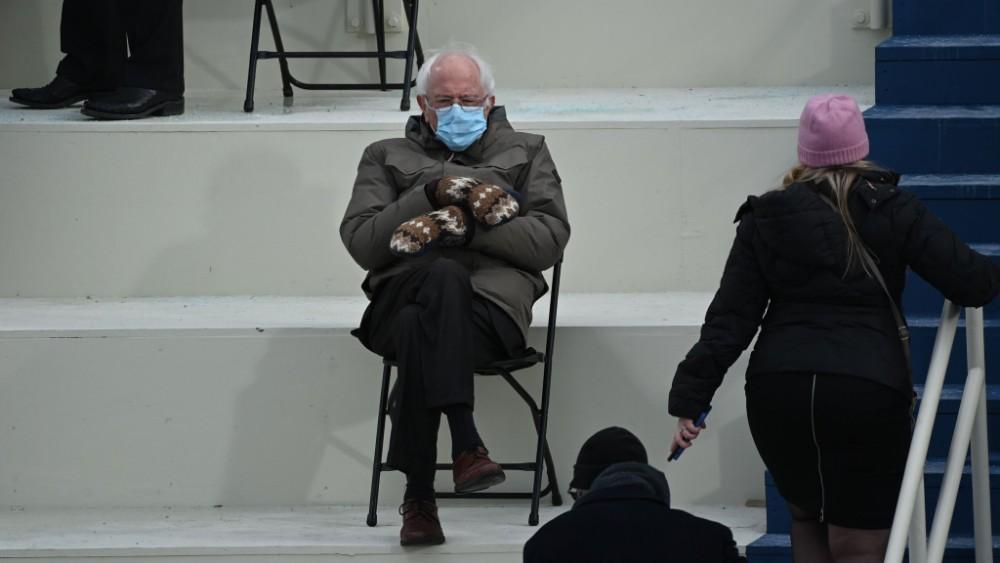 old man sitting on chair in winter Bernie Sanders