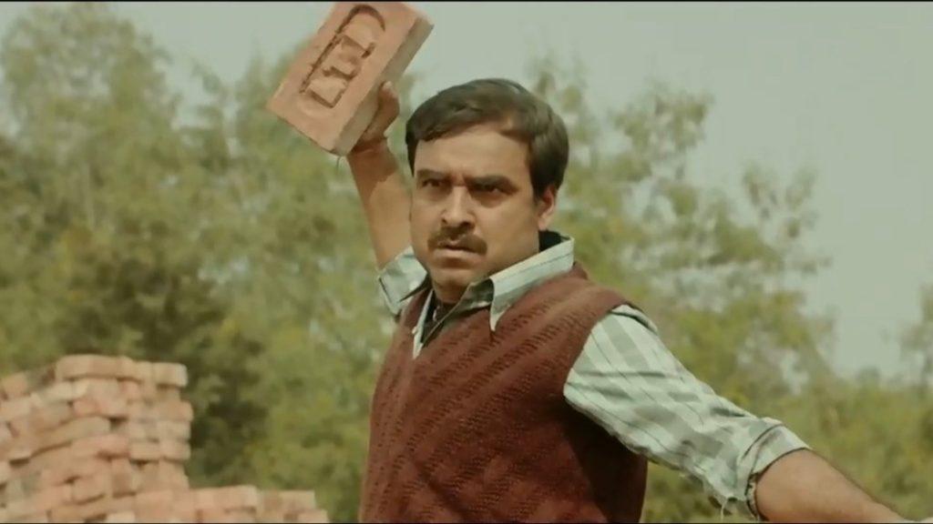 pankaj Tripathi throwing brick kaagaz meme template