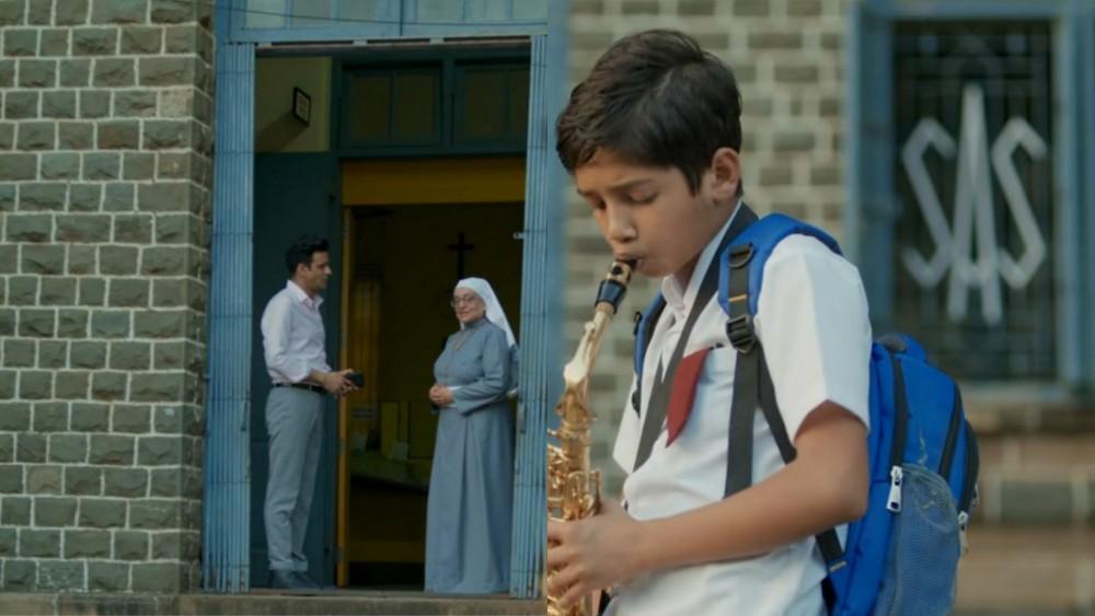 kid using trumpet scene family man template